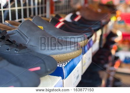 Many types of shoes at shoes shop.
