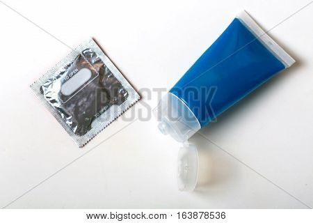 Close up Condom and gel isolated on white background.