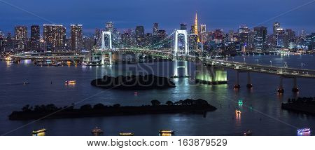 Panorama of Rainbow Bridge at night Tokyo Japan