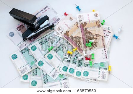 Multi-colored Buttons, Two Stapler And Money On A White Background  Разноцветные кнопки, два степлер