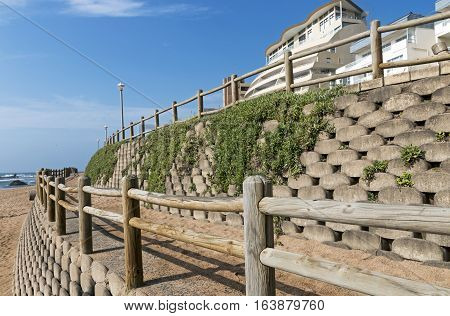 Retaining Wall And Wooden Barrier On Empty Beach