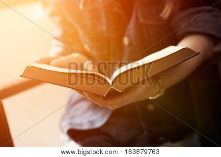 Asian Woman Relaxing In Holiday Time, Woman Reading Book With Vintage Picture Process Photography.