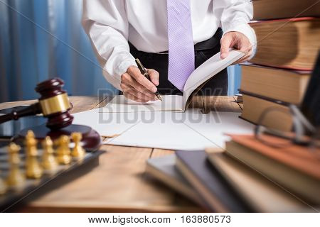 Young Lawyer Business Man Working With Paperwork On His Desk In Office Workplace, Consultant Lawyer