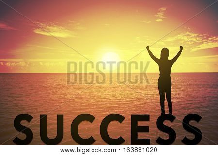 Silhouette young woman standing and raising up her hand about winner concept on success text over a beautiful sunset or sunrise at the sea. background for success in 2017 years .hope to business success