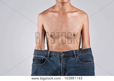 A Man In Bigger Jeans With Thin Body, Asian Man In Studio Photography.