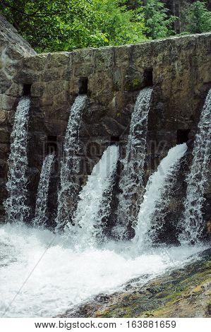 Mountain Dam In Summer