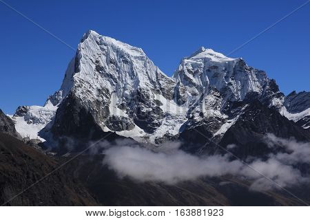 High mountain in the Everest National Park. Glacier covered Cholatse. View from Gokyo Ri.