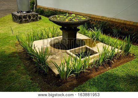 Beautiful garden with green grass and water fountain photo taken in Semarang Indonesia java