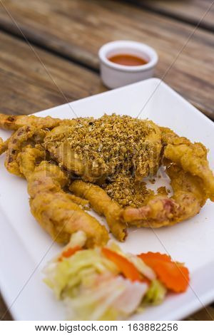 Fried Soft Shell Crab with Garlic on white plate, Thai food