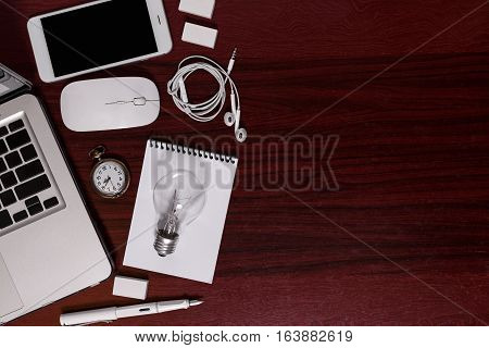 Top view of business elements & IT gadgets display on hard wood office flat lay of business equipment in workplace still life business concept.