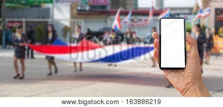 Walking the parade of take smart phone