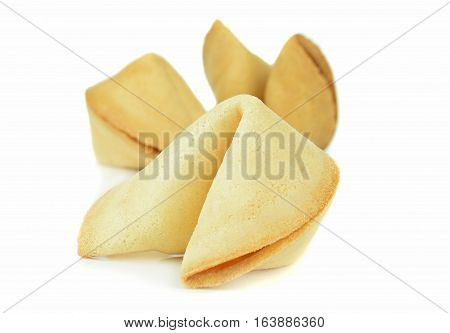 Close up of Chinese fortune cookies on a white background