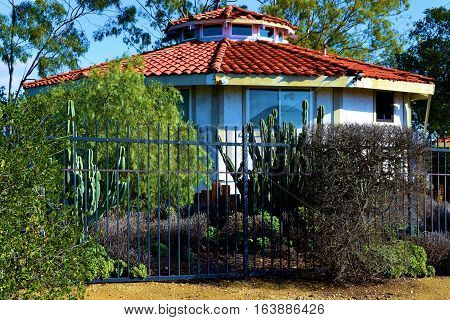 Spanish style Hacienda Villa with drought tolerant landscaping including chaparral shrubs and cacti