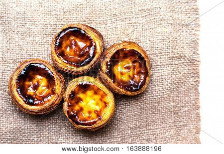 Dessert egg tart sweet custard pie isolated on white background. Pasteis de nata