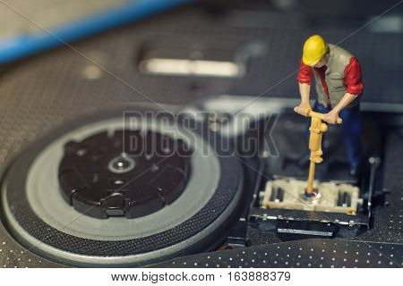 Miniature Worker Fixing The   Lens Inside The Computer