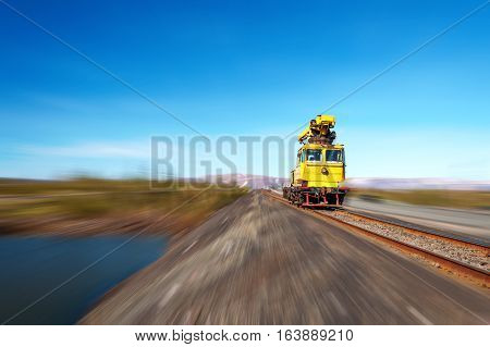 Railcar move along the railway. Abstract industrial background. The effect of motion blur.