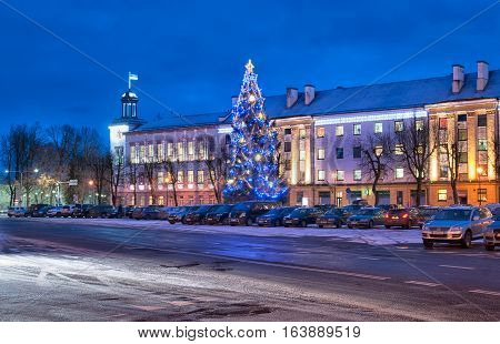 NARVA, ESTONIA - JANUARY 2, 2017: New Year Tree on The Peter Square. On the background is Narva City Council and Office. It is located next to the crossing point on  Estonian-Russian border