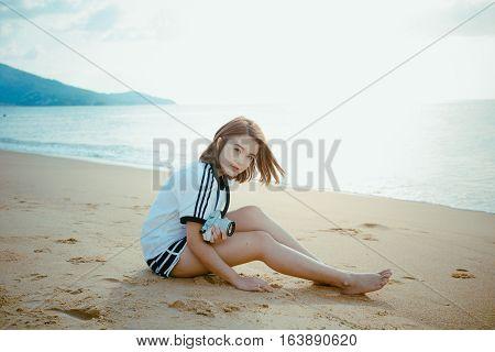 Bueatiful Girl Holdding Camera