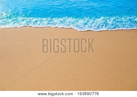 Blue Wave on the sand beach background.