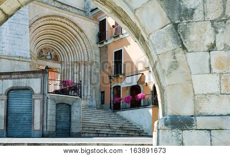 Italy Sulmona the portal of St.Francesco church seen from the Roman aqueduct