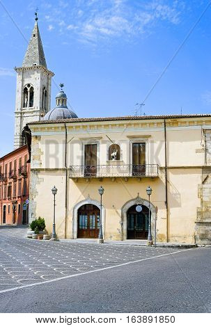 Sulmona Italy - September 8 2006: Side view of the Delle Palle palace with the bell tower in the background