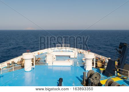 Front of a ferry boat while travelling at the sea.