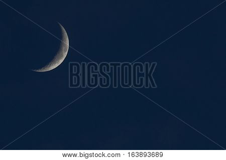 crescent of the moon in the night sky