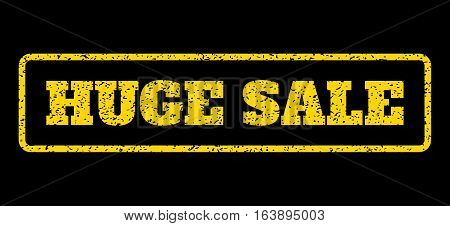 Yellow rubber seal stamp with Huge Sale text. Vector message inside rounded rectangular shape. Grunge design and dust texture for watermark labels. Horisontal sign on a blue background.