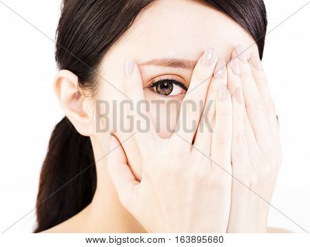 young woman covering her eyes by hands