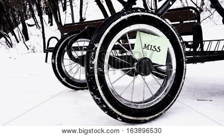 Wheel From The Baby Stroller In The Snow, The Words On The Paper Sticker