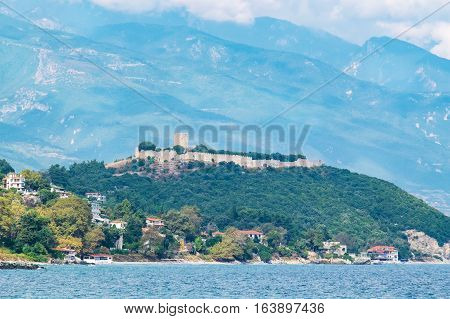 View of coastline with the medieval Fortress of Platamonas and Mount Olympus in the background. Pieria Macedonia Greece Europe