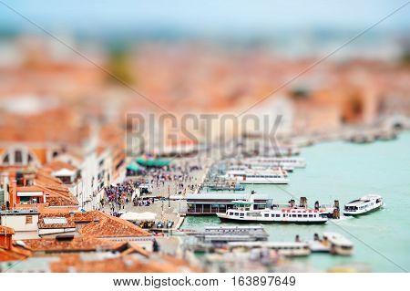 Grand Canal and Basilica Santa Maria della Salute Venice Italy. Miniature tilt shift lens effect.