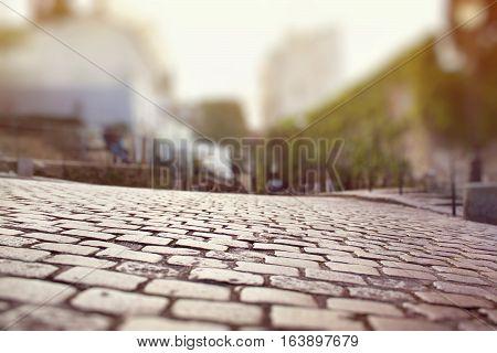 Closeup of the cobblestone pavement in Montmartre Paris. Miniature tilt shift lens effect.