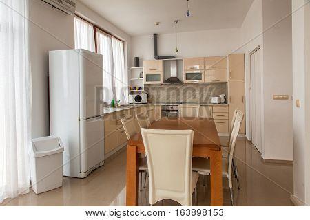 Modern kitchen interior with dinning room. Interior photography.