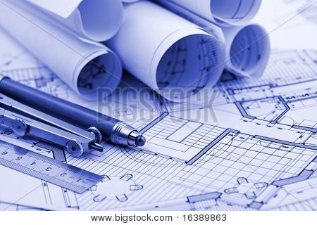 rolls of blueprints & work tools - ruler, pencil, compass