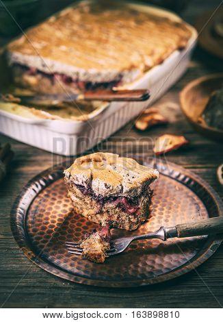 Apple bread pudding in baking dish, studio shot