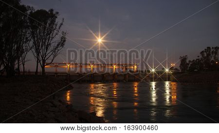 Full moon rising over the weir at Yarrawonga, Australia