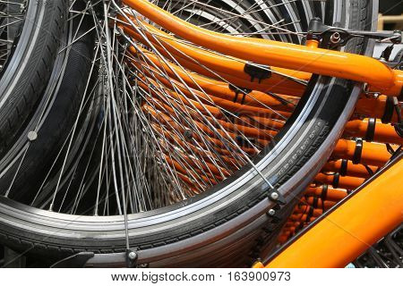 Orange Bicycle Wheels And The Many Spokes Of The Wheels