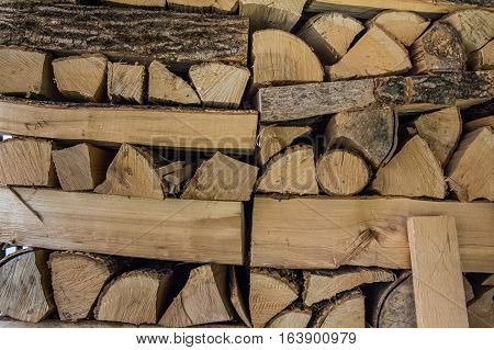 Wood depot with bundle of firewood in a village