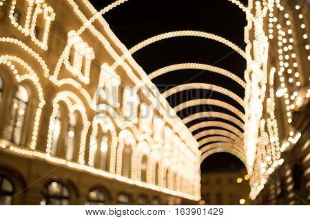 Blurred photo of building with festoons at night