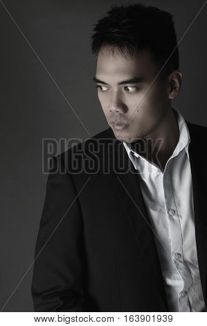 Portrait of an handsome Filipino over a gray background