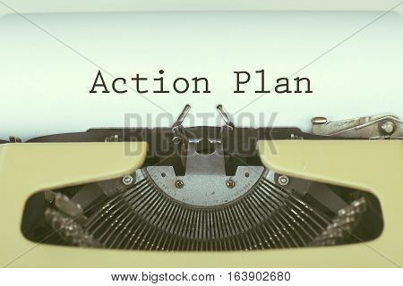 Action plan business concept with text on typewriter