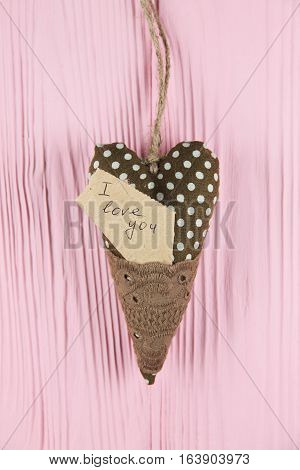 heart with an inscription on a pink background