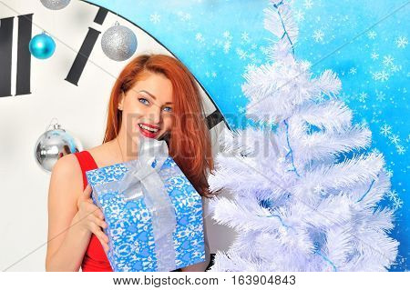 Smiling Young Woman With Christmas Present Box Near Christmas Tree
