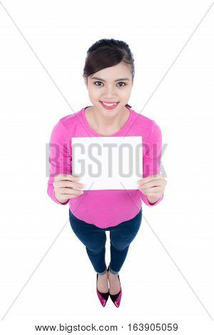 Fun and laughing beautiful female person with blank paper in hand. High angle view