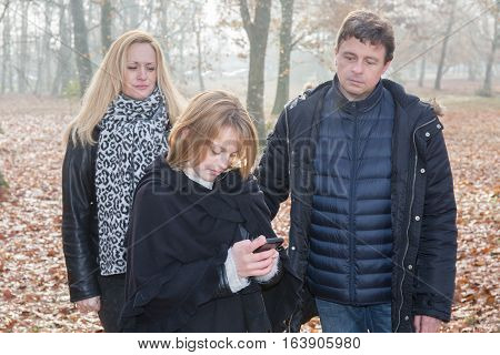 A Father And An Angry Mother After Their Daughter And Her Mobile Phone