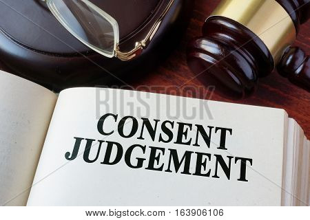Book with chapter Consent judgement and a gavel.