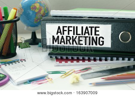 Affiliate marketing business concept with file in office