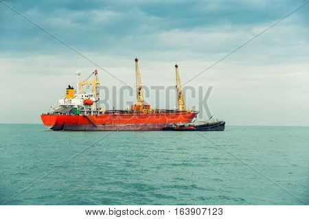 Shipping unloading in the ocean. Business transportation.