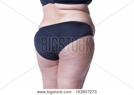 Fat female body with cellulite fatty hips and buttocks isolated on white background